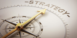 """compass pointing to word """"strategy"""""""