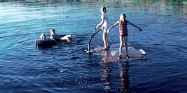 Children Playing in a Lake