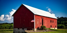 Red barn with American flag