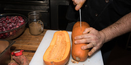 butternut squash being cut