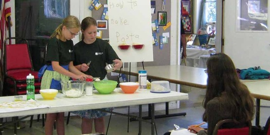 "4-H'ers give a presentation on ""How to make pasta"" at the 4-H Fair."