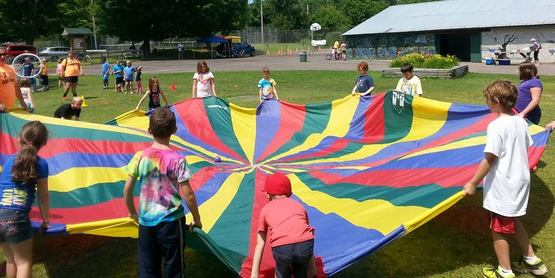 Day Campers playing with parachute