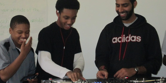 DJ Alykhan visits and teaches youth about DJ'ing