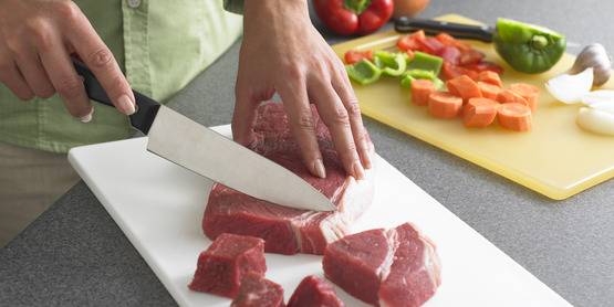 Use separate cutting boards for meats and produce