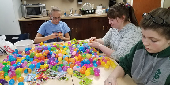 Teen Council members stuffing eggs prior to Spring Egg Hunt