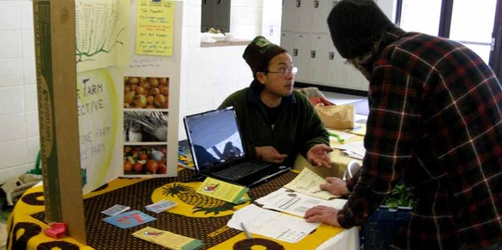 Chaw Chang of Stick & Stone Farm talks with a CSA Fair attendee.