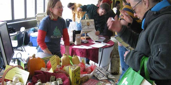 CSA farmers speak with prospective subscribers at the 2014 CSA Fair.