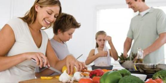family creating a healthy meal together
