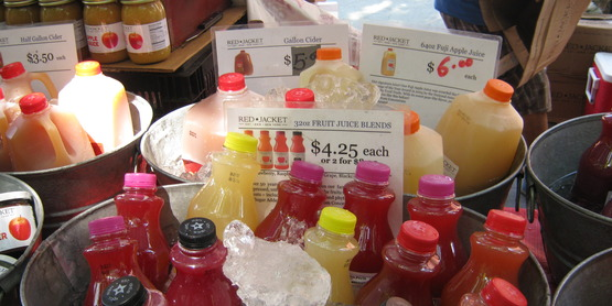 Red Jacket Orchards juices and ciders on display at an NYC farmers' market in July 2014