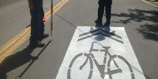 Painting sharrows on Delaware Avenue in Kingston