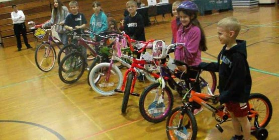 Award winners receive new bikes at Safety Fair at Caledonia Mumford School