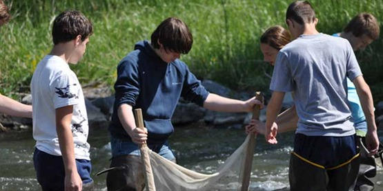 8th grade science students from Camillus Middle School using a Kick Seine Net to collect aquatic macroinvertebrates