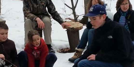 Homeschoolers learning how to make maple syrup