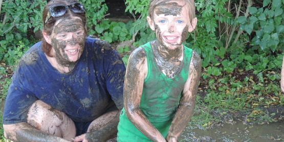 kids covered in mud on Mud Day