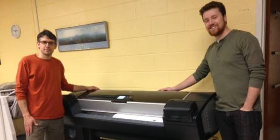 Neil Curri & Sean Carroll of the GIS Lab with their large-format printer