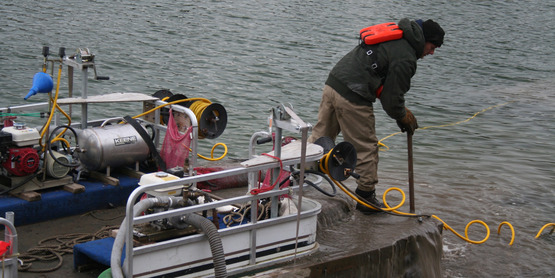 Suction assisted harvesting of hydrilla in Cayuga lake