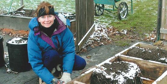 Master Gardener, Mary Harris, building raised beds.