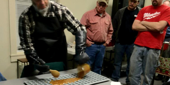 Steve Childs, Cornell state maple specialist, giving a demonstration on making maple candy at a maple program workshop. (2012)