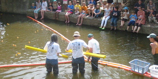 Volunteers await the arrival of the first duck at the 4-H Rubber Duck Race, Ithaca NY