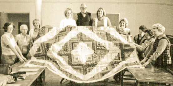 CCE Community Group shows off its quilt, year unknown