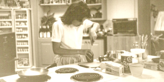 CCE homemaker demonstrates cooking, year unknown