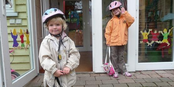 Two girls on their way to kindergarten