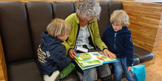grandmother reading to children