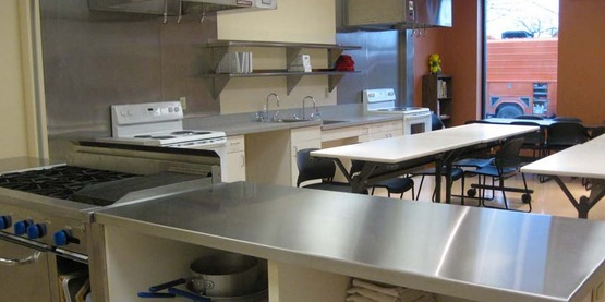 Commercial Demonstration Area Overlooking The Four Teaching Kitchen Stations .