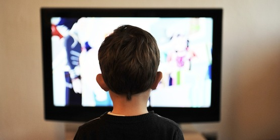 A child watching a tv show