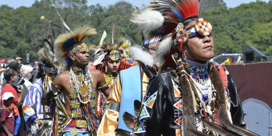 Shinnecock tribal members in ceremonial attire at their annual Pow Wow.