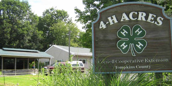 Entry to 4H Acres with Kiwanis Hall in background, on Lower Creek Road, Ithaca NY