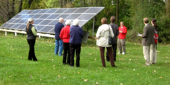 Visitors on the 2008 Green Buildings Open House Tour learn about solar panels from the homeowner (Trumansburg, NY)