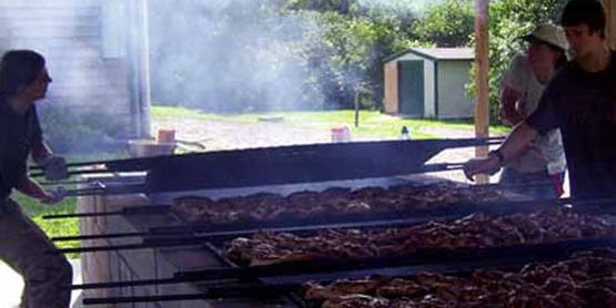 Youth-run BBQ at 4-H Acres covered BBW pit