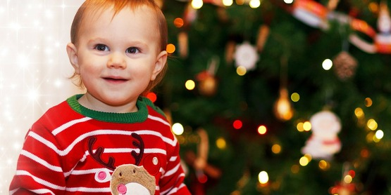 A young boy excited for Christmas