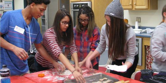 RAPP Youth prepare dog biscuits to be donated to Pets Alive.