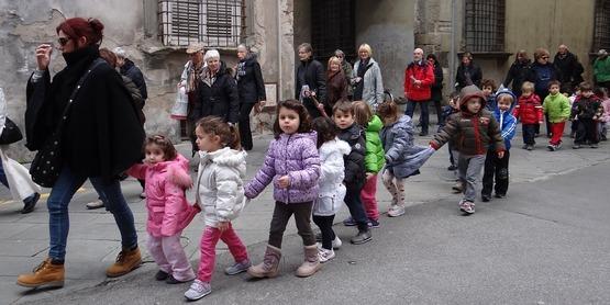 kindergarten children on their way to school