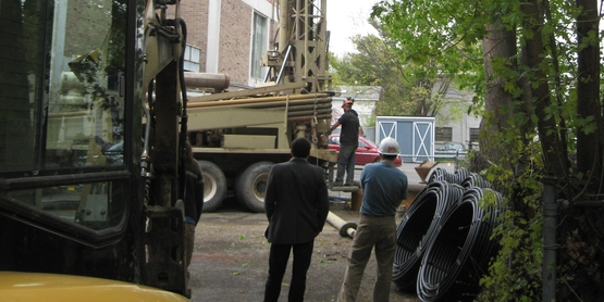 Installing vertical-wells for a geothermal system at Taitem Engineering's main office.