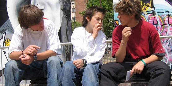 Teenagers in Barcelona having their first cigarette