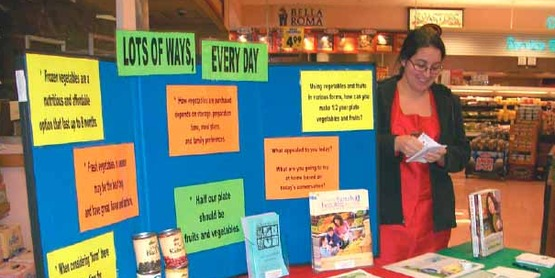 Nutrition Program Educator Christine Lathan doing outreach at the Price Chopper.