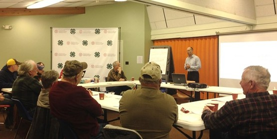 Chautauqua County Vegetable Producers listen as Judson Reid with the Cornell Vegetable Pro