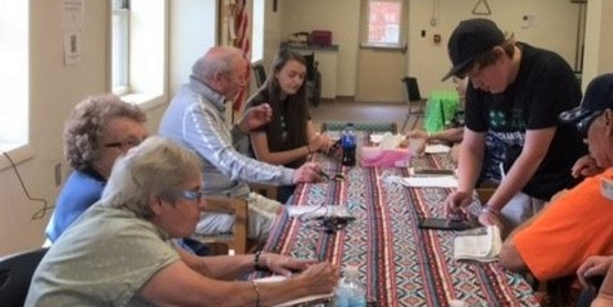 4-h Tech Changemakers working with seniors teaching them how to use their cellphones and tablets