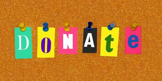 "cut out letters spelling ""donate"" on a cork bulletin board, built from scratch by Sandy Repp"