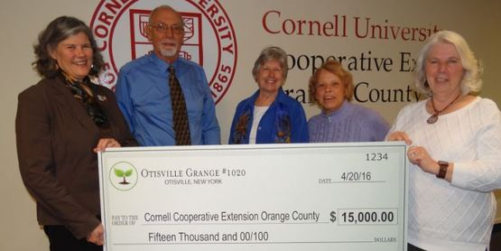 Lee Runnells and Gerda Krogslund of Otisville Grange presenting a generous to the Park in April of 2016.
