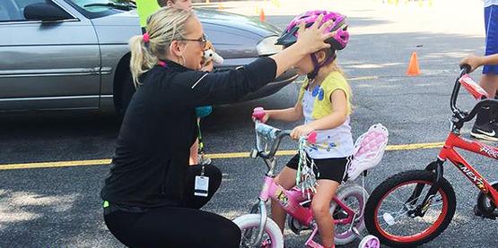 Katelyn fitting a helmet.