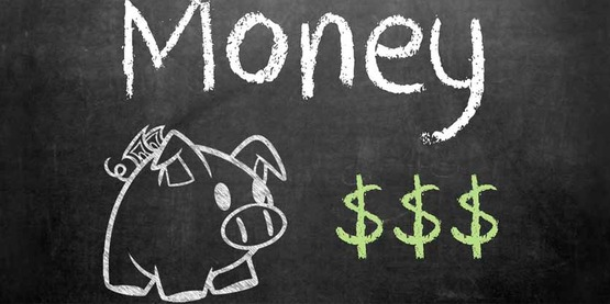 "The word ""money"" and a drawing of a piggy bank on a chalkboard"
