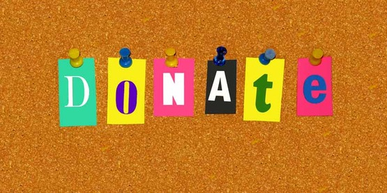 """cut out letters spelling """"donate"""" on a cork bulletin board, built from scratch by Sandy Repp"""