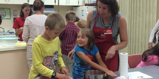 Kristin Porter, MG Volunteer cooks up the harvest with Junior MGs in 2016.