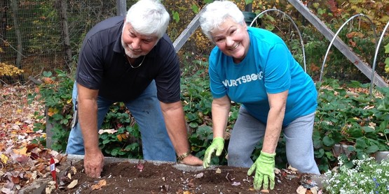 Dennis Hewston and Susan Swann, MG Volunteers, clean up the garden beds in fall of 2016.