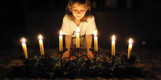 child with passover candles