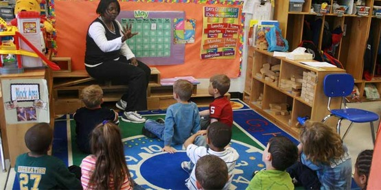 Teacher and students in an early childhood setting.